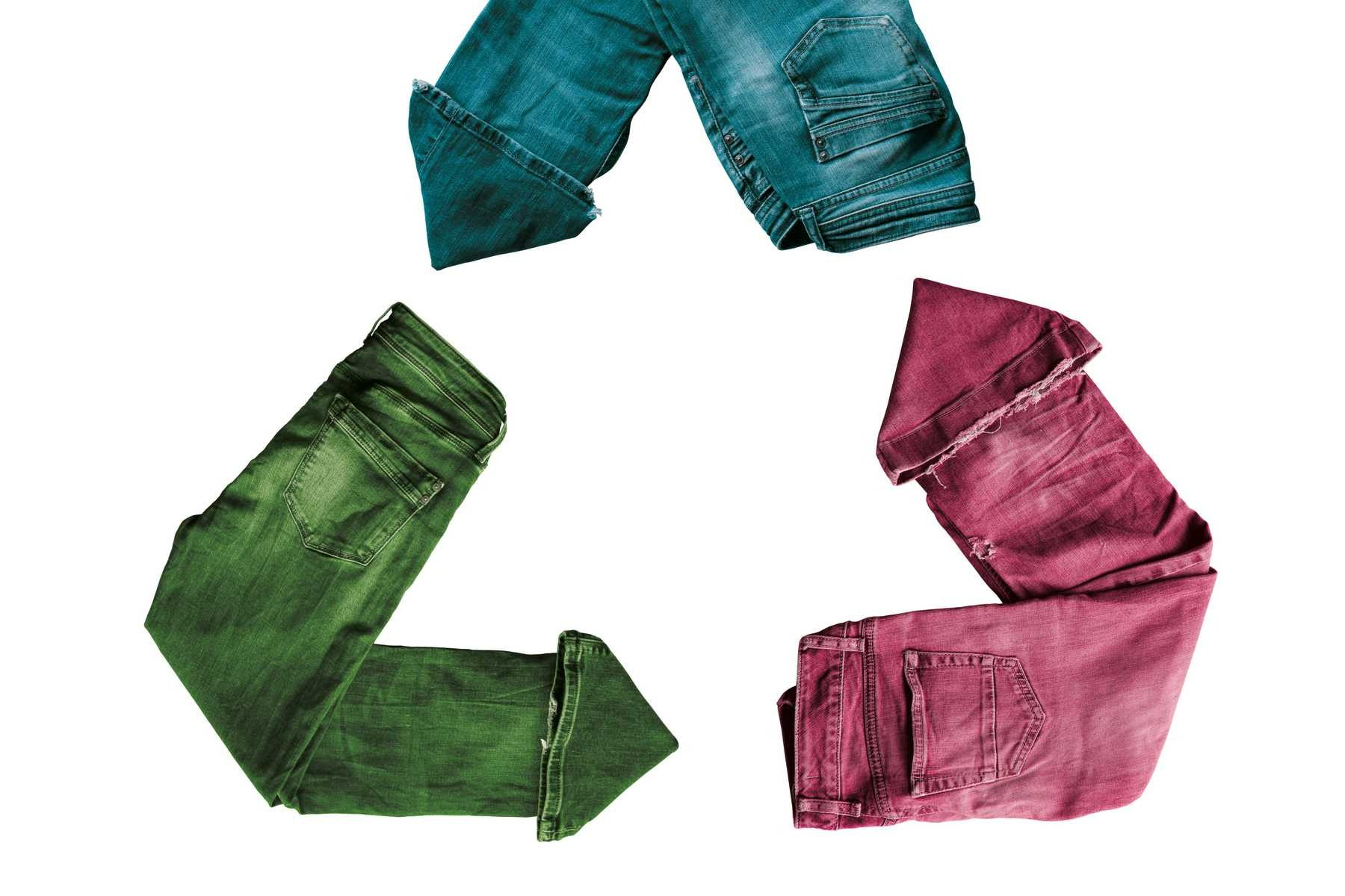 Your unused clothing will be recycled. Pants with different colors arranged in the recycle symbol.